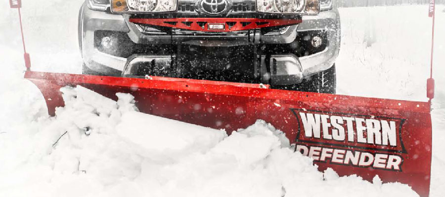 Western Snow Plow available at Markham Mower clearing a road