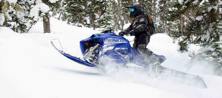 Yamaha Snow Mobile, found at Markham Mower, going up a mountain
